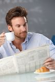 Man with coffee and morning papers Royalty Free Stock Photos