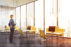 Man with coffee in open space panoramic office stock images