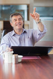 Man in a coffee shop calling the waiter Stock Images