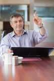 Man in a coffee shop calling a waiter Royalty Free Stock Photography