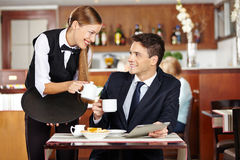 Man in coffee shop flirting with waiter Stock Photos