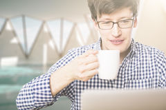 Man with coffee using laptop Royalty Free Stock Images