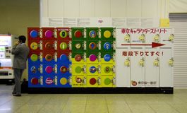 Man coin locker railway station. Man using mobile phone near coin locker at Tokyo railway station Royalty Free Stock Photo