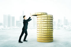 Man with coins tower concept Royalty Free Stock Photos