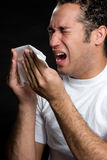 Man With Cold. Sick sneezing man with cold Stock Photo