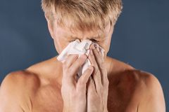 Man with cold and flu illness suffering from a headache stock image