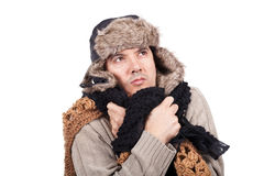 Man with cold wearing a scarf and a bonnet. Young man with cold wearing a scarf and a bonnet Royalty Free Stock Photos