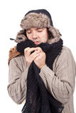 Man with cold wearing a scarf and a bonnet Royalty Free Stock Image