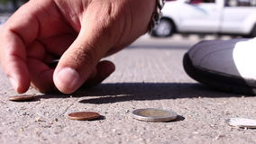 Man collect coins on street stock video footage
