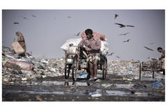 A man collect dust from slum in Sylhet Bangladesh Royalty Free Stock Image