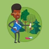 Man collecting garbage in forest. Royalty Free Stock Photos