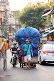 Plastic bottle collector, Hanoi, Vietnam. A  man collecting plastic bottles in Hanoi, Vietnam, with blue tarpaulin Stock Photo