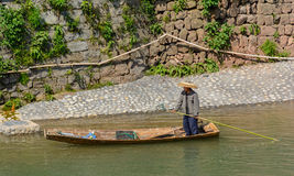 Man collecting rubbish in the river. Man collecting rubbish on the bank of river royalty free stock images
