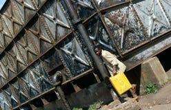 A man collecting water, Uganda Royalty Free Stock Image