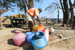 Man collects drinking water in Adamans. An unidentified man collects drinking water from public tap in Port Blair, Andamans,India. Andamans being an Island faces royalty free stock image