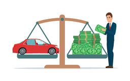 Man collects money for a car and weighs in the balance Business Royalty Free Stock Images