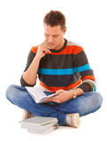 Man college student reading book studying for exam Royalty Free Stock Image