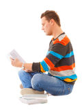 Man college student sitting and reading book study. Ing for exam isolated. Studio shot Stock Image