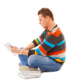 Man college student sitting and reading book studying for exam. Isolated. Studio shot Royalty Free Stock Image
