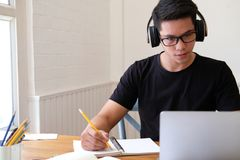 Man college student  studying learning lesson with computer online taking note