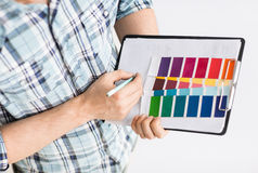 Man with color samples for selection Royalty Free Stock Image