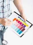 Man with color samples for selection Stock Photography