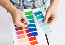 Man with color samples for selection Stock Photo
