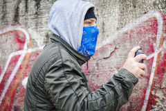 Man with color spray can near the old wall Stock Photo
