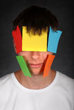 Man with Colored Paper on Face Stock Photos