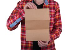 A man holding booklet. A man in a colored shirt holding a blank booklet stock images