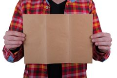 A man holding booklet. A man in a colored shirt holding a blank booklet royalty free stock photos