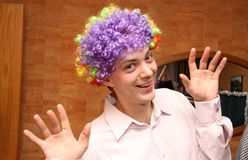 Man in colored wig Stock Photo