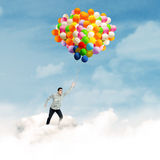 Man with colorful balloons Royalty Free Stock Photography