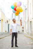 Man with colorful balloons in the city Royalty Free Stock Photos