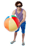 Man with a colorful big beach ball Stock Photos