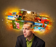 Man with colorful glowing photo memories concept Stock Photos
