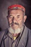 Man with colourful cap in Tajikistan Stock Image