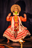 Man with colourful mask in Kerala. Ernakulam, Kerala - circa February 2012: Man in colourful mask and costume performs Kathakali, stylized classical Indian dance Royalty Free Stock Photography
