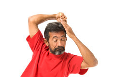 Man combing hair Stock Photography