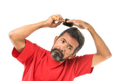 Man combing hair Royalty Free Stock Images