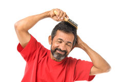 Man combing hair Royalty Free Stock Image