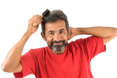 Man combing hair Royalty Free Stock Photos