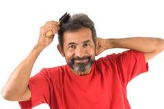 Man combing hair Royalty Free Stock Photos
