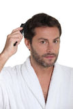 Man combing hair Stock Image