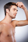 Man combing hair. Stock Photography