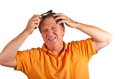 Man combing his hair Stock Image