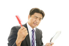 Man combing his hair Royalty Free Stock Photo