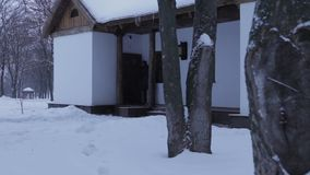 Man comes to the old house on the street where it snows and winter stock video footage