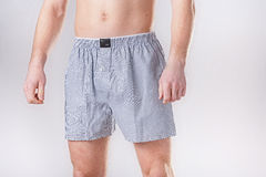 The man in comfortable shorts Royalty Free Stock Photos