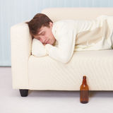 Man comfortable sleeps on sofa having got drunk Royalty Free Stock Photography